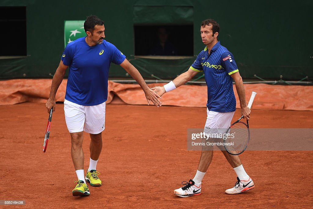 Radek Stepanek of Czech Republic and <a gi-track='captionPersonalityLinkClicked' href=/galleries/search?phrase=Nenad+Zimonjic&family=editorial&specificpeople=243242 ng-click='$event.stopPropagation()'>Nenad Zimonjic</a> of Serbia talk tactics during the Men's Doubles third round match against Bob Bryan of the United States and Mike Bryan of the United States on day eight of the 2016 French Open at Roland Garros on May 29, 2016 in Paris, France.