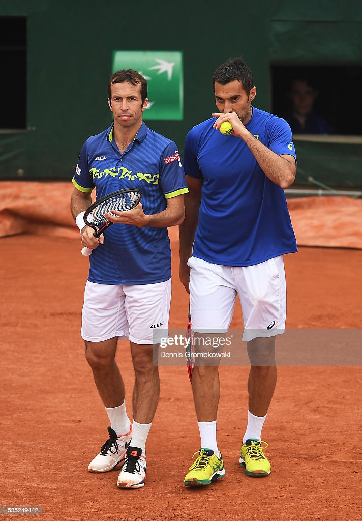 <a gi-track='captionPersonalityLinkClicked' href=/galleries/search?phrase=Radek+Stepanek&family=editorial&specificpeople=193842 ng-click='$event.stopPropagation()'>Radek Stepanek</a> of Czech Republic and <a gi-track='captionPersonalityLinkClicked' href=/galleries/search?phrase=Nenad+Zimonjic&family=editorial&specificpeople=243242 ng-click='$event.stopPropagation()'>Nenad Zimonjic</a> of Serbia talk tactics during the Men's Doubles third round match against Bob Bryan of the United States and Mike Bryan of the United States on day eight of the 2016 French Open at Roland Garros on May 29, 2016 in Paris, France.
