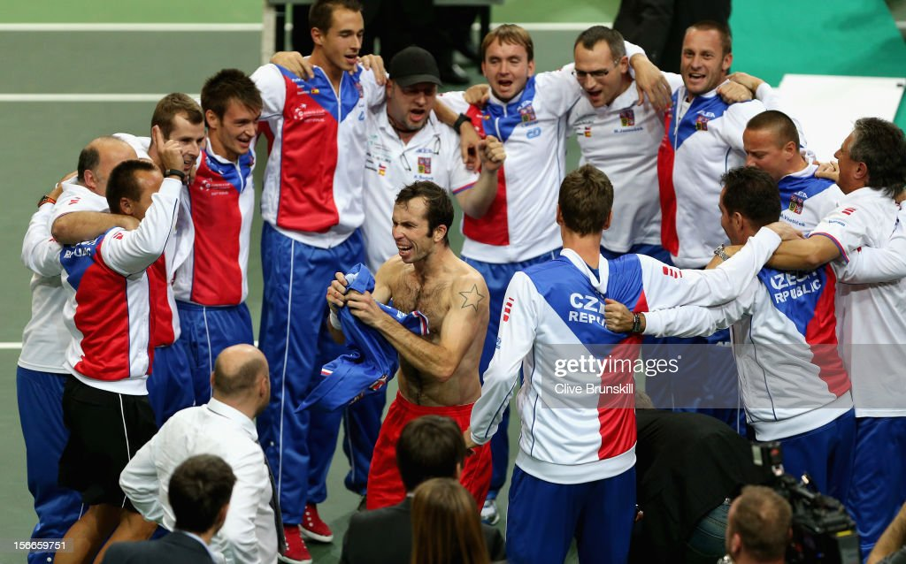 <a gi-track='captionPersonalityLinkClicked' href=/galleries/search?phrase=Radek+Stepanek&family=editorial&specificpeople=193842 ng-click='$event.stopPropagation()'>Radek Stepanek</a> of Czech Republic dances with his team mates after ripping his shirt after celebrating match point against Nicolas Almagro of Spain during day three of the final Davis Cup match between Czech Republic and Spain at the 02 Arena on November 18, 2012 in Prague, Czech Republic.