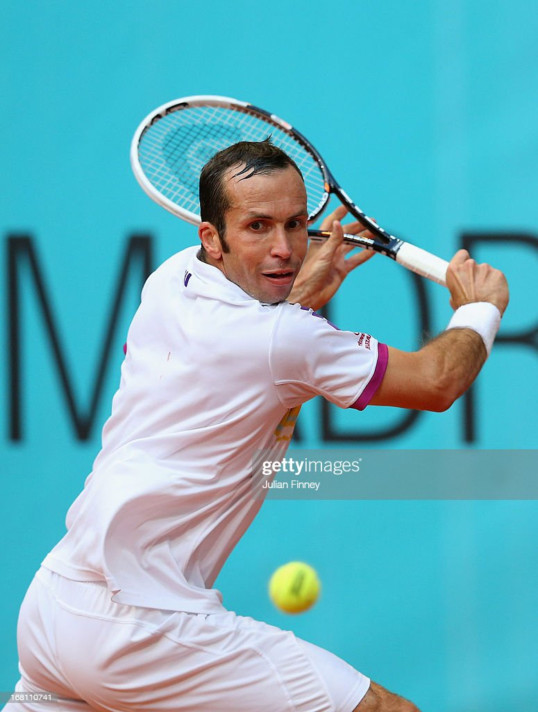 <a gi-track='captionPersonalityLinkClicked' href=/galleries/search?phrase=Radek+Stepanek&family=editorial&specificpeople=193842 ng-click='$event.stopPropagation()'>Radek Stepanek</a> of Czech Republic in action against Bernard Tomic of Australia during day two of the Mutua Madrid Open tennis tournament at the Caja Magica on May 5, 2013 in Madrid, Spain.