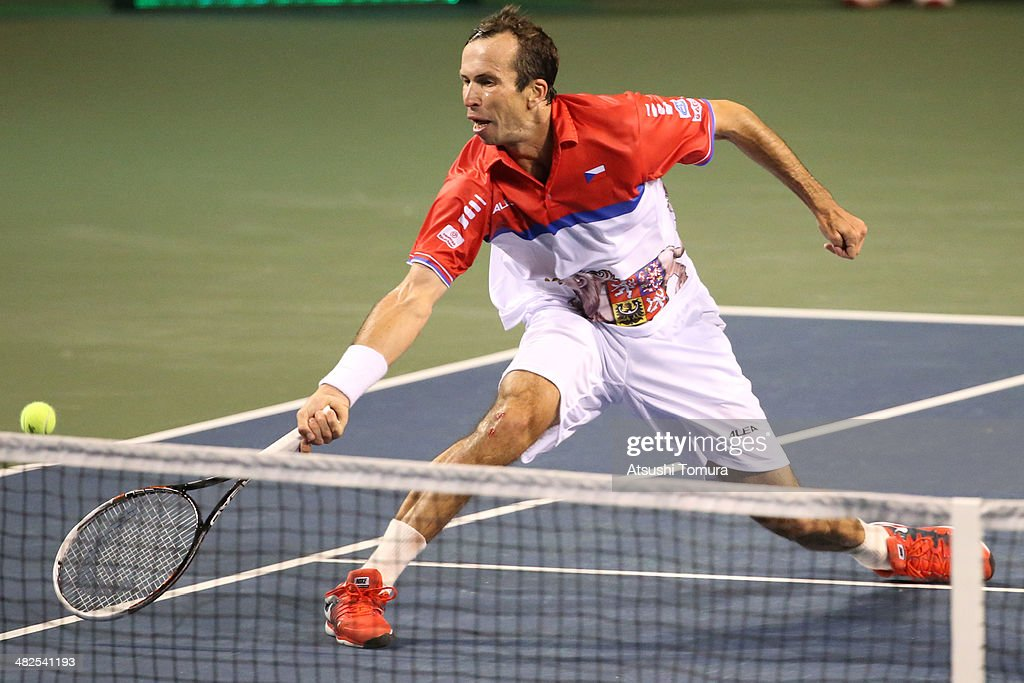 <a gi-track='captionPersonalityLinkClicked' href=/galleries/search?phrase=Radek+Stepanek&family=editorial&specificpeople=193842 ng-click='$event.stopPropagation()'>Radek Stepanek</a> of Czech Republic in action against Tatsuma Ito of Japan in a match between Japan v Czech Republic during the Davis Cup world group quarterfinals on April 4, 2014 in Tokyo, Japan.