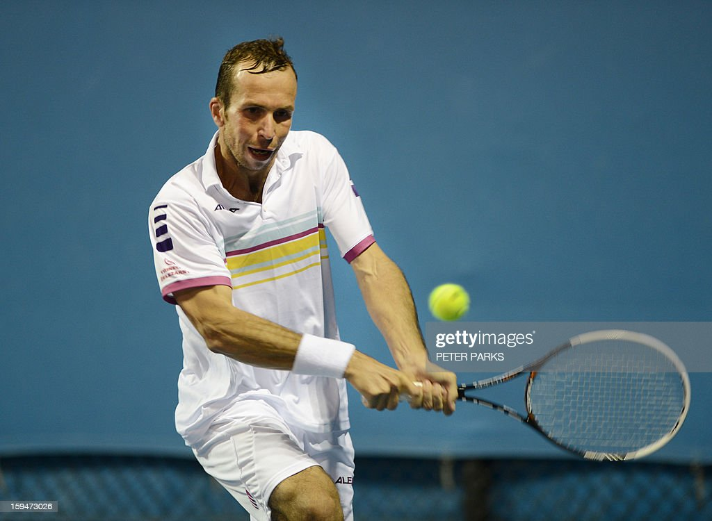 Radek Stepanek of Czech Republic plays a return during his men's singles match against Viktor Troicki of Serbia the first day of the Australian Open tennis tournament in Melbourne on January 14, 2013. AFP PHOTO/PETER PARKS IMAGE STRICTLY RESTRICTED TO EDITORIAL USE - STRICTLY NO COMMERCIAL USE