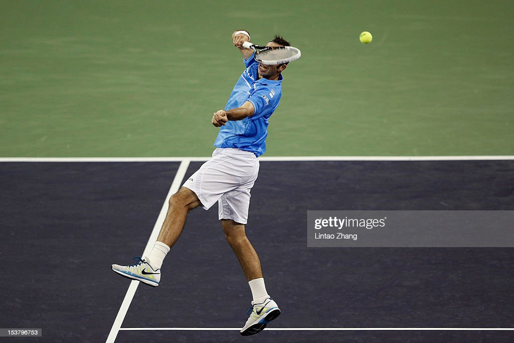 Radek Stepanek of Czech Republic returns a shot to Lleyton Hewitt of Australia during day three of Shanghai Rolex Masters at the Qi Zhong Tennis Center on October 9, 2012 in Shanghai, China.