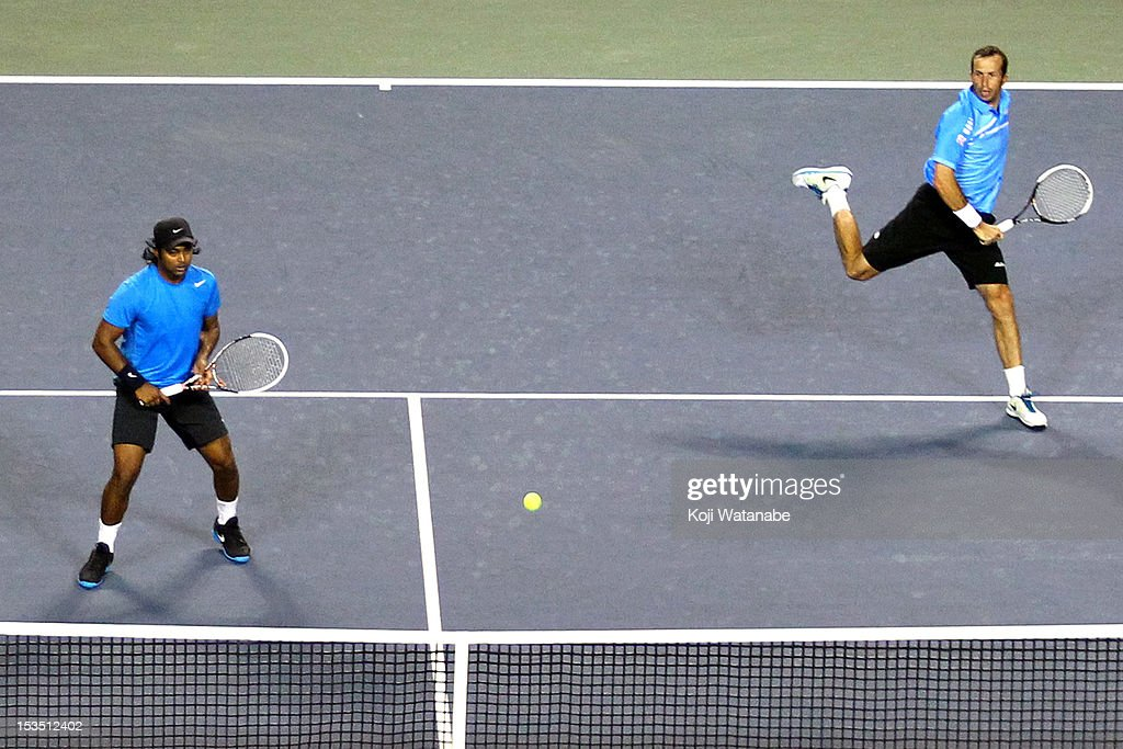 Radek Stepanek of the Czech Republic (R) and Leander Paes of India in action their semi final doubles match against Daniele Bracciali of Italy and Frantisek Cermak of the Czech Republic during day six of the Rakuten Open at Ariake Colosseum on October 6, 2012 in Tokyo, Japan.