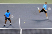 Radek Stepanek of the Czech Republic and Leander Paes of India in action their semi final doubles match against Daniele Bracciali of Italy and...