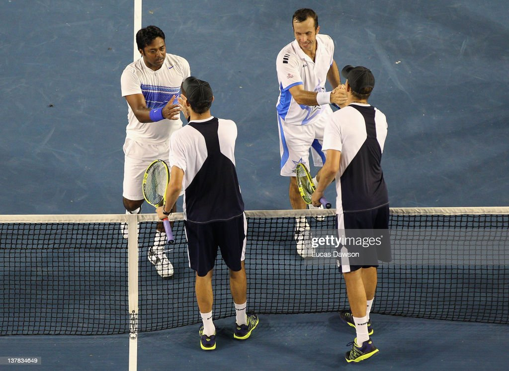 Radek Stepanek of the Czech Republic and Leander Paes of India celebrate championship point after winning their mens' doubles final match against Bob Bryan and Mike Bryan of the United States of America during day thirteen of the 2012 Australian Open at Melbourne Park on January 28, 2012 in Melbourne, Australia.