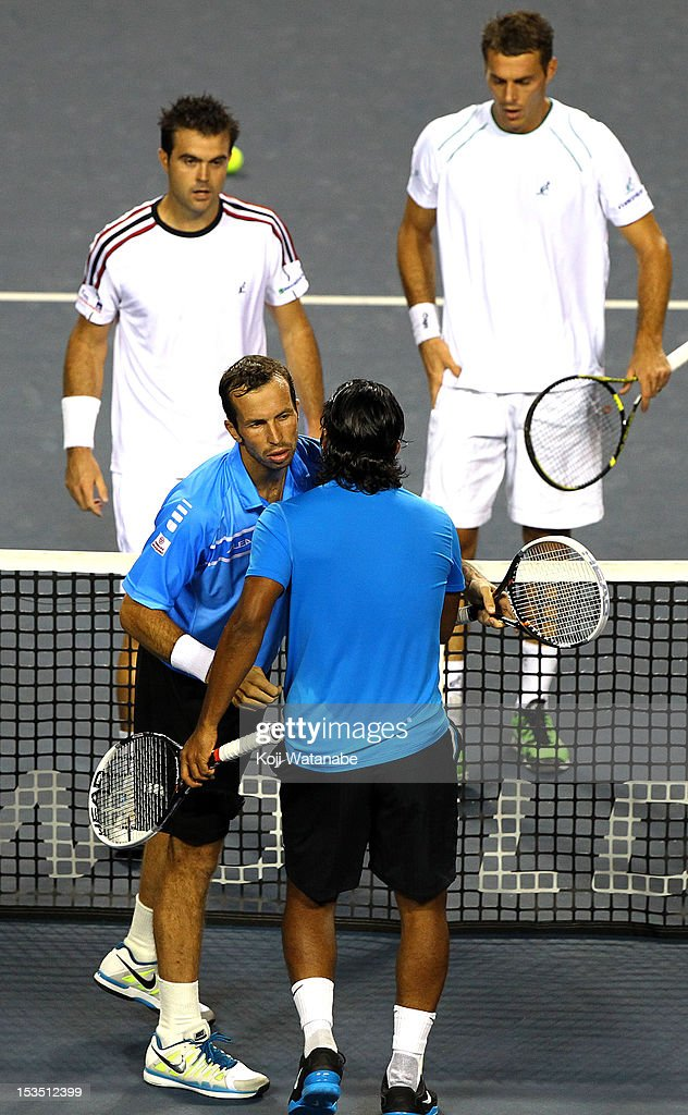 Radek Stepanek (L) of the Czech Republic and Leander Paes of India stand at the net after their semi final doubles match against Daniele Bracciali of Italy and Frantisek Cermak of the Czech Republic during day six of the Rakuten Open at Ariake Colosseum on October 6, 2012 in Tokyo, Japan.