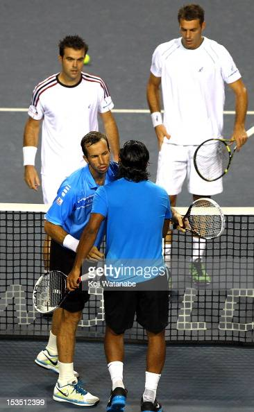 Radek Stepanek of the Czech Republic and Leander Paes of India stand at the net after their semi final doubles match against Daniele Bracciali of...