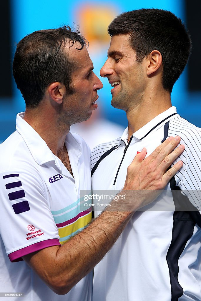 Radek Stepanek (L) of the Czech Republic congratulates Novak Djokovic of Serbia after Djokovic won their third round match against during day five of the 2013 Australian Open at Melbourne Park on January 18, 2013 in Melbourne, Australia.