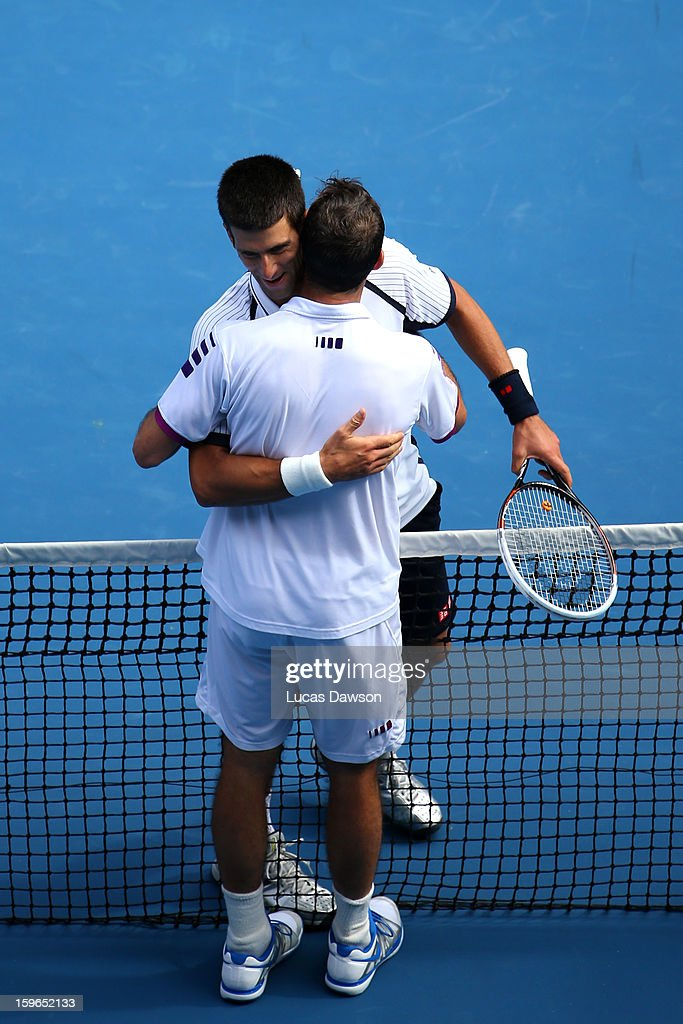 Radek Stepanek (R) of the Czech Republic congratulates Novak Djokovic of Serbia after Djokovic won their third round match against during day five of the 2013 Australian Open at Melbourne Park on January 18, 2013 in Melbourne, Australia.