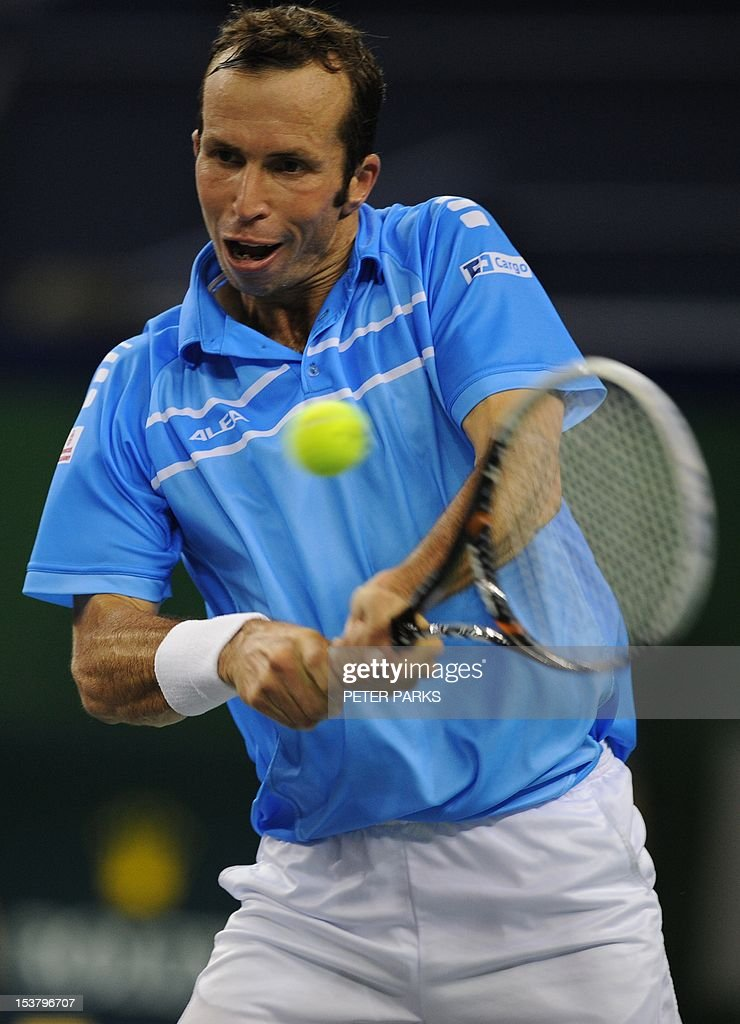 Radek Stepanek of the Czech Republic hits a return to Lleyton Hewitt of Australia in their first round match of the Shanghai Masters tennis tournament in Shanghai, on October 9, 2012. AFP PHOTO / Peter PARKS