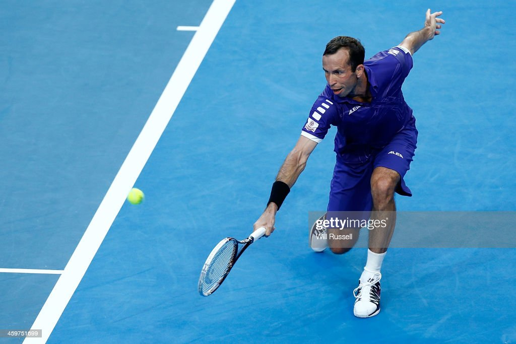 Radek Stepanek of the Czech Republic plays a backhand in the men's singles match against Jo-Wilfried Tsonga of France during day three of the Hopman Cup at Perth Arena on December 30, 2013 in Perth, Australia.