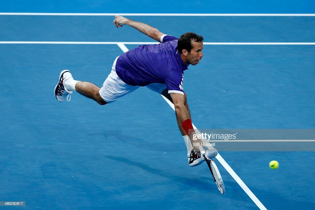 Radek Stepanek of the Czech Republic plays a forehand in the men's singles match against Milos Raonic of Canada playing as a substitute for John Isner of the United States who retired injured during day seven of the Hopman Cup at Perth Arena on January 3, 2014 in Perth, Australia.