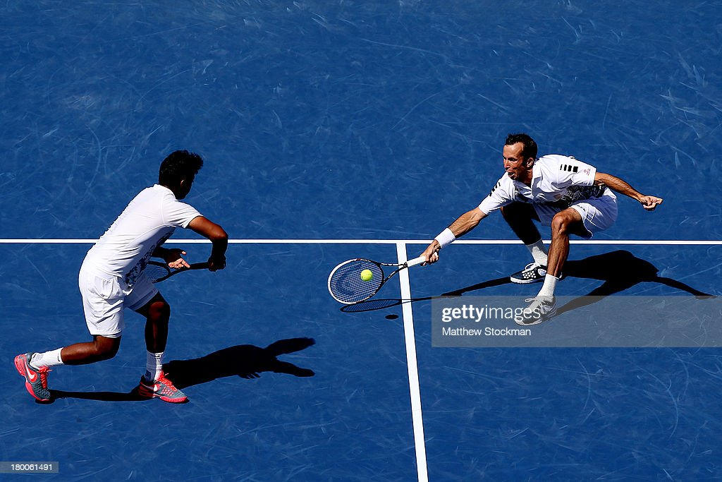 Radek Stepanek of the Czech Republic plays a forehand next to his partner Leander Paes of India during their men's doubles final against Alexander Peya of Austria and Bruno Soares of Brazil on Day Fourteen of the 2013 US Open at the USTA Billie Jean King National Tennis Center on September 8, 2013 in the Flushing neighborhood of the Queens borough of New York City. Paes and Stepanek defeated Peya and Soares 6-1 6-3.