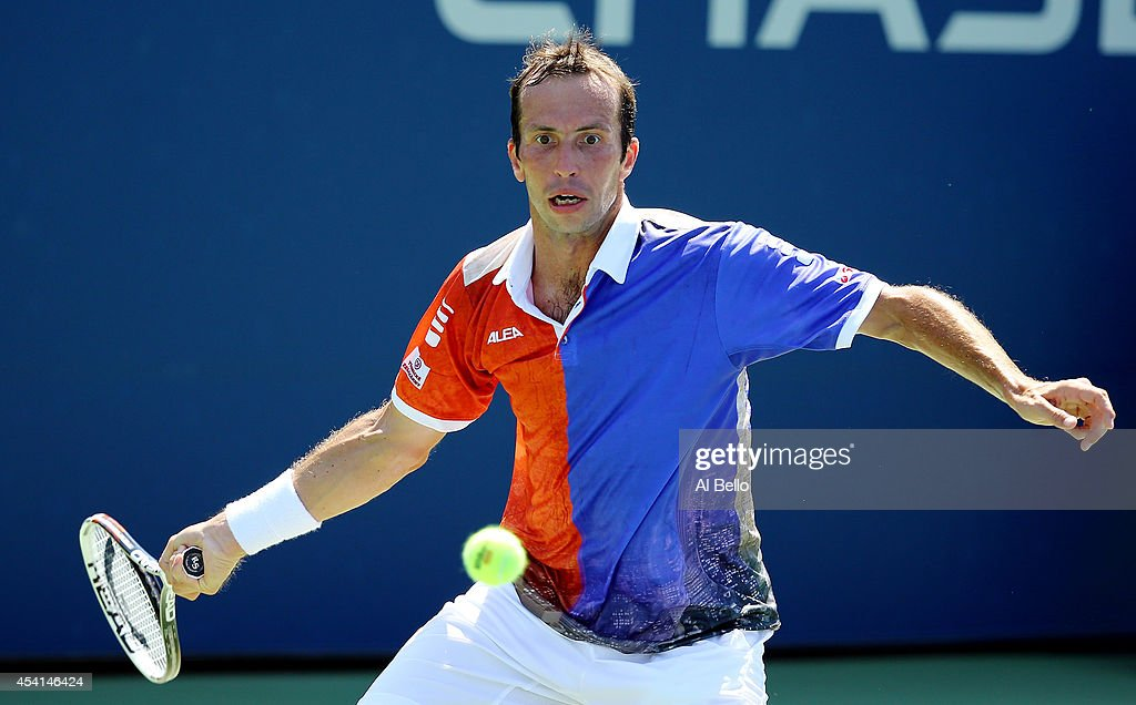 Radek Stepanek of the Czech Republic returns a shot to Matthias Bachinger of Germany during their men's singles first round match on Day One of the 2014 US Open at the USTA Billie Jean King National Tennis Center on August 25, 2014 in the Flushing neighborhood of the Queens borough of New York City.