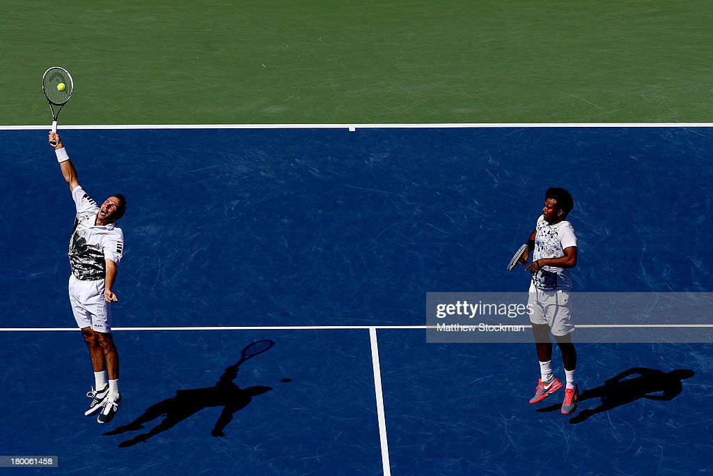 Radek Stepanek of the Czech Republic smashes the ball next to his partner Leander Paes of India during their men's doubles final against Alexander Peya of Austria and Bruno Soares of Brazil on Day Fourteen of the 2013 US Open at the USTA Billie Jean King National Tennis Center on September 8, 2013 in the Flushing neighborhood of the Queens borough of New York City. Paes and Stepanek defeated Peya and Soares 6-1 6-3.