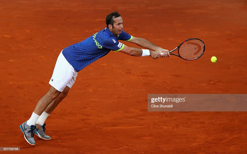 Radek Stepanek of the Czech Republic stretches to play a backhand against Andy Murray of Great Britain in their second round match during day four of the Mutua Madrid Open tennis tournament at the Caja Magica on May 03, 2016 in Madrid,Spain.