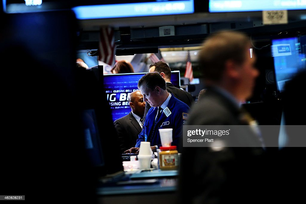 raders work on the floor of the New York Stock Exchange on January 15, 2014 in New York City. The Dow rallied for a second straight day closing up 108 points.