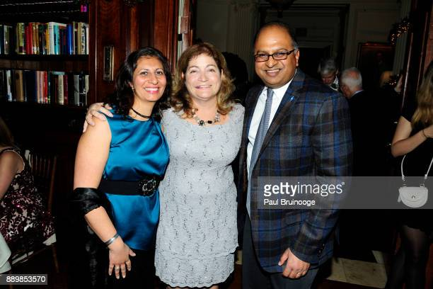 Radhika Sahu Laura Barrett and Dr Sharad Sahu attend the Hackensack University Medical Center Foundation Holiday Party Hosted by Jon Fitzgerald Diane...