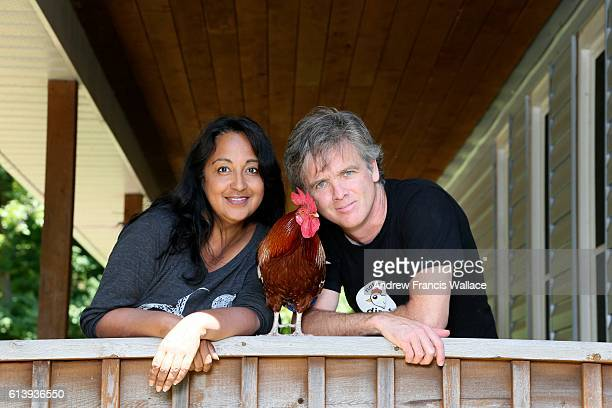 TORONTO ON JULY 27 Radhika Subramanyan and pBrian Kelly pose with pBlizzard a rooster who wears diapers at the family home in Burlington July 27 2016