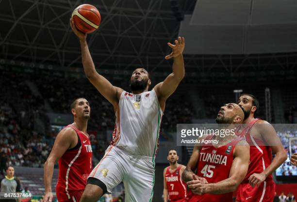 Radhouane Slimane of Tunisia in action against Abderrahim Najah of Morocco during the AfroBasket 2017 semi final round between Tunisia and Morocco at...