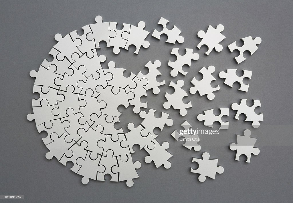 Radiating silver metal puzzle, half assembled : Stock Photo