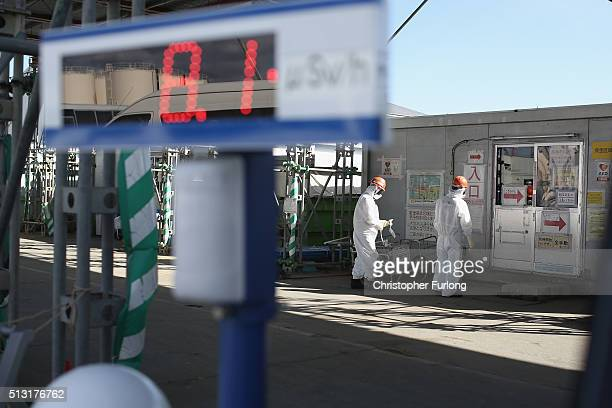 A radiation monitor sits outside the antiseismic building as the decontamination process continues at the Tokyo Electric Power Co's embattled...