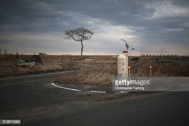 A radiation monitoring station stands in the tsunami scarred landscape inside the exclusion zone close to the devastated Fukushima Daiichi Nuclear...