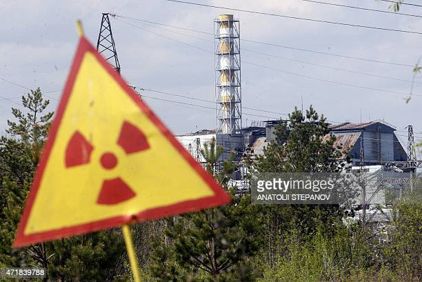 A radiation sign is seen in front of the Chernobyl Nuclear Power plant after firefighters have nearly extinguished a forest fire near Chernobyl plant...