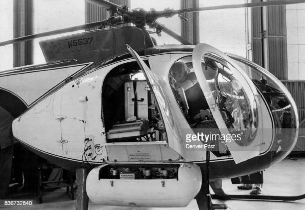 RadiationDetection Flight Readied Engineer John Cleland readies equipment in a helicopter for the craft to fly over Denver in search of radioactive...