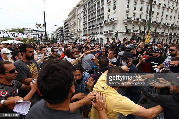Radical anarchy group members fight with peaceful protestors during a protest against plans for new austerity measures June 15 2011 in Athens Greece...