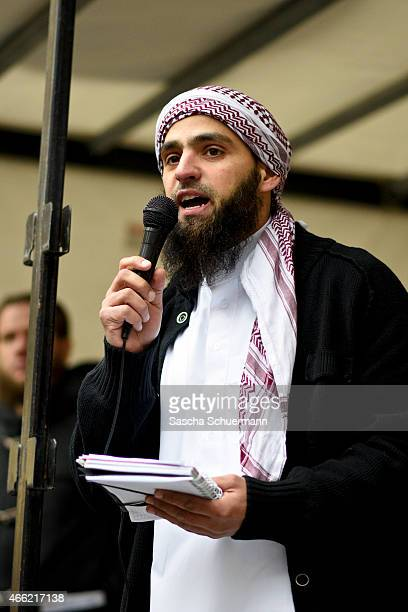 Radical Islamic convert Abu Abdullah speaks to Salafi supporters at a public gathering on March 14 2015 in Wuppertal Germany Several hundred Salafis...