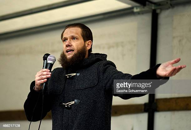 Radical Islamic convert Sven Lau speaks to Salafi supporters at a public gathering on March 14 2015 in Wuppertal Germany Several hundred Salafis who...