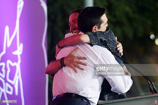 Radical left Syriza leader Alexis Tsipras hugs leader of Spain's Podemos party Pablo Iglesias during Syriza party's main preelection rally in central...