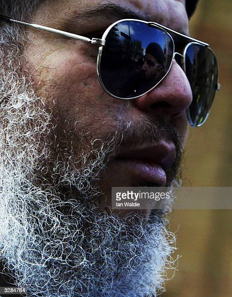 Radical Muslim cleric Abu Hamza leads worshipers at Finsbury Park Mosque as members of the extreme rightwing group the National Front hold a...