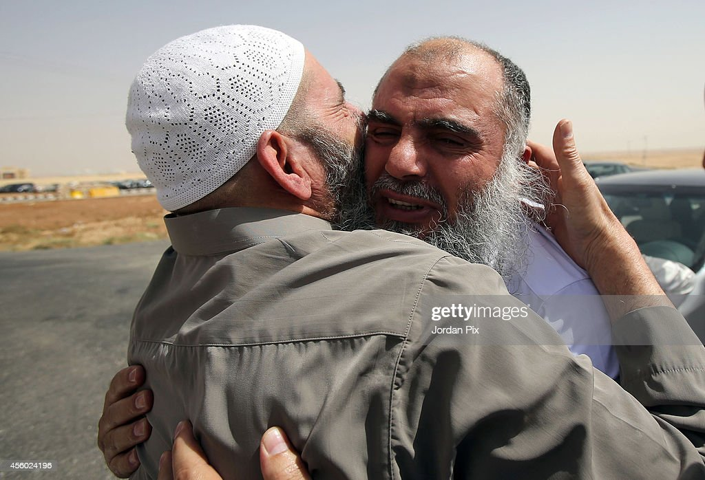 Radical Muslim cleric <a gi-track='captionPersonalityLinkClicked' href=/galleries/search?phrase=Abu+Qatada&family=editorial&specificpeople=643772 ng-click='$event.stopPropagation()'>Abu Qatada</a> (R) is greeted by his father upon his release from prison of Al Muwaqar east of Amman after being found not guilty of terrorism charges, on September 24, 2014 in Amman, Jordan. The radical Muslim Cleric, who's real name is Omar Othman, was deported to Jordan from the UK in 2013. Judges said there was insufficient evidence to convict him of charges related to a terrorist plot in 2000. The British Home Office have said that he remains a threat to national security and will not be returning to the UK.