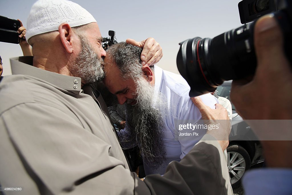 Radical Muslim cleric <a gi-track='captionPersonalityLinkClicked' href=/galleries/search?phrase=Abu+Qatada&family=editorial&specificpeople=643772 ng-click='$event.stopPropagation()'>Abu Qatada</a> (C) is greeted by his father upon his release from prison of Al Muwaqar east of Amman after being found not guilty of terrorism charges, on September 24, 2014 in Amman, Jordan. The radical Muslim Cleric, who's real name is Omar Othman, was deported to Jordan from the UK in 2013. Judges said there was insufficient evidence to convict him of charges related to a terrorist plot in 2000. The British Home Office have said that he remains a threat to national security and will not be returning to the UK.