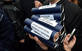 Radical Party supporters hold diplomas as they protest against Serbian President Tomislav Nikolic outside the presidency building in Belgrade Serbia...
