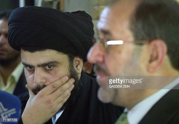 Radical Shiite cleric Moqtada alSadr gestures during a joint press conference with Iraqi prime minister designate Nuri alMaliki in the holy city of...