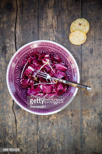 Radicchio salad with pea sprouts in a bowl and rosemary-corn waffles