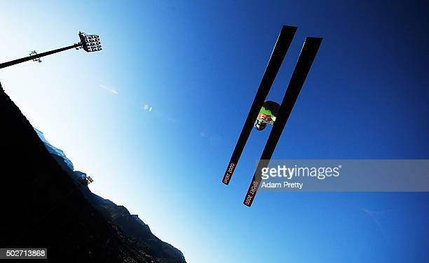 Radik Zhaparov of Kazakhstan soars through the air during his training jump on Day 1 of the 64th Four Hills Tournament ski jumping event on December...