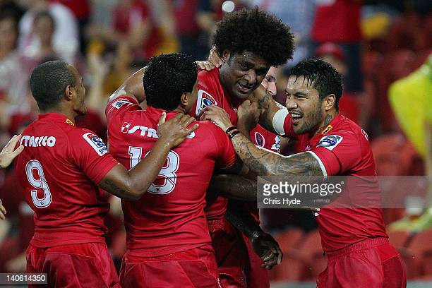 Radike Samo of the Reds celebrates with team mates after scoring a try during the round two Super Rugby match between the Reds and the Western Force...
