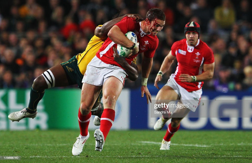<a gi-track='captionPersonalityLinkClicked' href=/galleries/search?phrase=Radike+Samo&family=editorial&specificpeople=212939 ng-click='$event.stopPropagation()'>Radike Samo</a> of the Wallabies tackles <a gi-track='captionPersonalityLinkClicked' href=/galleries/search?phrase=George+North&family=editorial&specificpeople=7320853 ng-click='$event.stopPropagation()'>George North</a> of Wales during the 2011 IRB Rugby World Cup bronze final match between Wales and Australia at Eden Park on October 21, 2011 in Auckland, New Zealand.