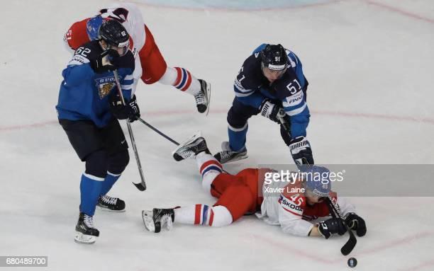 Radim Simek of Czech Republic is slash by Valtteri Filppula and Oskar Osala of Finland during the 2017 IIHF Ice Hockey World Championship game...