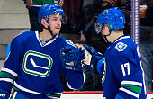 Radim Vrbata congratulates Sven Baertschi of the Vancouver Canucks who scored his second goal of the game against the Edmonton Oilers during their...