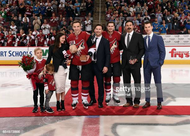 Radim Vrbata of the Arizona Coyotes and his family are presented an award by teammates Shane Doan Oliver EkmanLarsson NHL represenative George Parros...