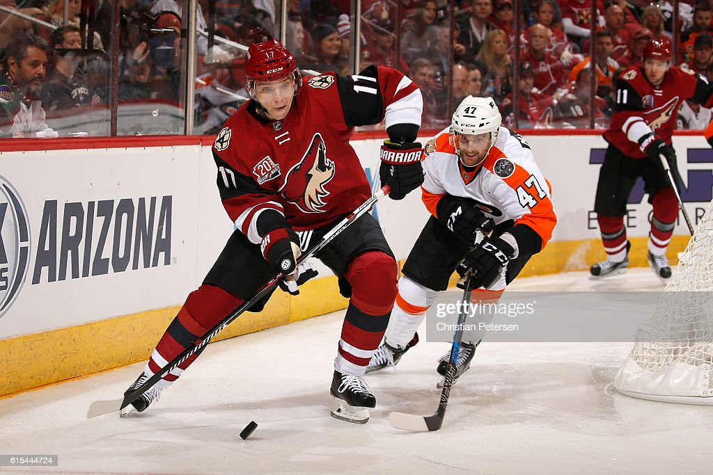 Radim Vrbata #17 of the Arizona Coyotes handles the puck ahead of Andrew MacDonald #47 of the Philadelphia Flyers during the NHL game at Gila River Arena on October 15, 2016 in Glendale, Arizona. The Coyotes defeated the Flyers 4-3 in overtime.