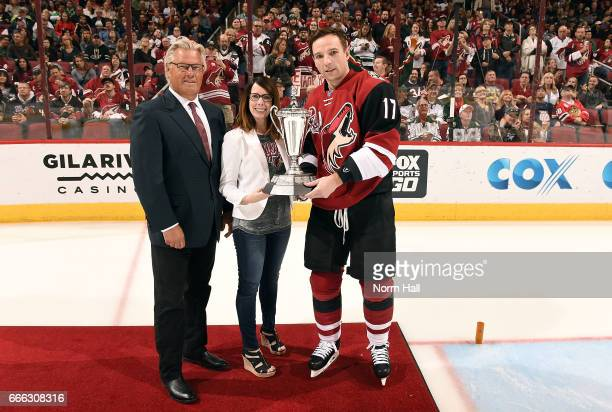 Radim Vrbata of the Arizona Coyotes is presented with the Desert Schools Leading Scorer Award by Craig Stewart and Kari Watts during the team awards...