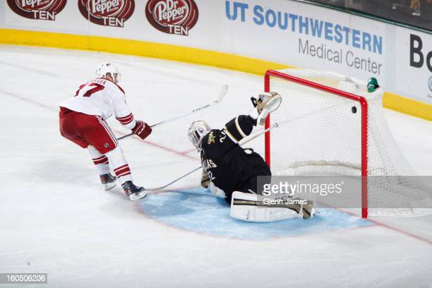 Radim Vrbata of the Phoenix Coyotes goes in for the shoot out goal against Kari Lehtonen of the Dallas Stars at the American Airlines Center on...