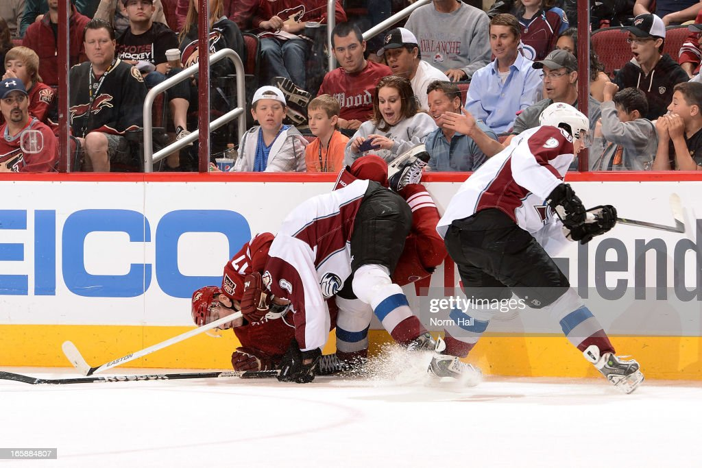 <a gi-track='captionPersonalityLinkClicked' href=/galleries/search?phrase=Radim+Vrbata&family=editorial&specificpeople=204716 ng-click='$event.stopPropagation()'>Radim Vrbata</a> #17 of the Phoenix Coyotes is checked into the boards by <a gi-track='captionPersonalityLinkClicked' href=/galleries/search?phrase=Jan+Hejda&family=editorial&specificpeople=624333 ng-click='$event.stopPropagation()'>Jan Hejda</a> #8 of the Colorado Avalanche as teammate <a gi-track='captionPersonalityLinkClicked' href=/galleries/search?phrase=Matt+Duchene&family=editorial&specificpeople=4819304 ng-click='$event.stopPropagation()'>Matt Duchene</a> #9 clears the puck during the third period at Jobing.com Arena on April 6, 2013 in Glendale, Arizona.